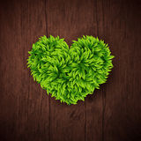 Natural background with wooden board and heart made of leaves. V Stock Image