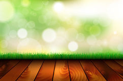 Natural background with wooden floor, grass and bokeh Royalty Free Stock Photography