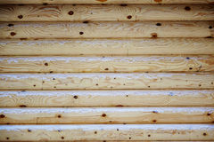 Natural background of the wooden wall of the new logs. Stock Photos