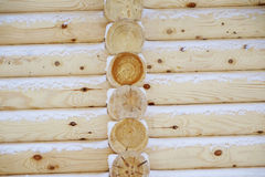 Natural background of the wooden wall of the new logs. Royalty Free Stock Photos