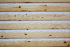 Natural background of the wooden wall of the new logs. Royalty Free Stock Photo