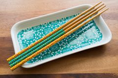 NATURAL BAMBOO CHOPSTICKS and plate on wooden table background stock image