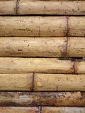 Natural bamboo fence background texture. Asian brown horizontal. Sticks pattern. Yellow dry bark bundled into a wall or floor finish Royalty Free Stock Photos