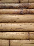 Natural bamboo fence background texture. Yellow dry bark bundled. Into a wall or floor finish. Asian brown horizontal sticks pattern Royalty Free Stock Photo
