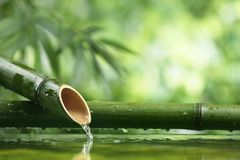 Natural  bamboo fountain. Traditional asian bamboo fountain,Closeup Royalty Free Stock Photography