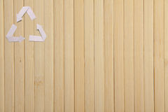 Natural bamboo texture and paper recycle symbol Royalty Free Stock Photography