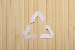 Natural bamboo texture and paper recycle symbol Royalty Free Stock Images