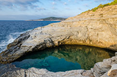 Natural basin. In rocky shore royalty free stock photo