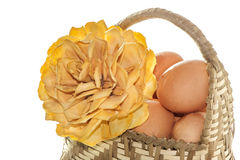 Natural basket with eggs and flowers Royalty Free Stock Images