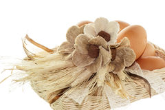 Natural basket with eggs and flowers Royalty Free Stock Photos