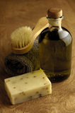 Natural Bath. Ingredients... soap, apothecary bottle of olive oil and complexion brush Royalty Free Stock Image