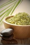 Natural bath salt. Bowl of bath salt an green leaves - beauty treatment Royalty Free Stock Images
