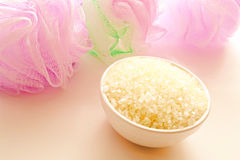 Natural Bath Sea Salts and Cosmetic Bath Sponges Royalty Free Stock Photo