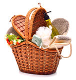 Natural bath sponges, pumice, gel and flowers in the basket Stock Photos
