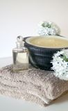 Natural Bathroom Spa. Organic bath oil, massage candle and towel for relaxing session in spa Royalty Free Stock Photo