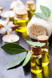 Natural bay laurel essential oil for beauty and spa. Healthy lifestyle concept. Natural bay laurel essential oil, essence in glass bottle with leaves, towels and stock photo