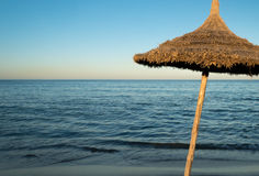 Natural Beach Umbrella (5). Natural Beach Umbrella with, Sky and Horizon Stock Photography