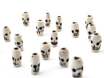 Natural beads skull from carved bone on white background Royalty Free Stock Image
