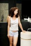 Natural beautiful woman in bathroom. stock photos