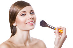 Natural beautiful woman with brush Royalty Free Stock Image