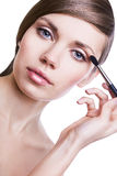 Natural beautiful woman with cosmetic brush Royalty Free Stock Images