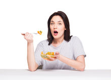 Natural beautiful young woman heaving a healthy fruit meal, isol Royalty Free Stock Image