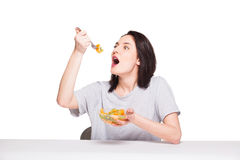 Natural beautiful young woman heaving a healthy fruit meal, isol Stock Photo