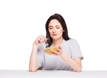 Natural beautiful young woman heaving a healthy fruit meal, isol Stock Photography