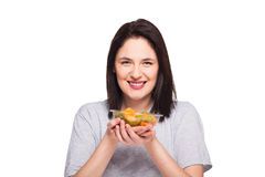 Natural beautiful young woman heaving a healthy fruit meal, isol Stock Photos