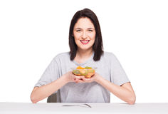 Natural beautiful young woman heaving a healthy fruit meal, isol Royalty Free Stock Photo