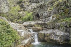 Natural and beautifull river waterfall. S, schist rocks, vegetation in Portugal Stock Photography