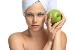 Natural beauty. Beautiful blonde girl in towel and fresh apple spa Royalty Free Stock Images