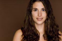 Natural Beauty 17. A naturally beautiful brunette on a brown backdrop Royalty Free Stock Image