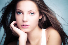 Natural beauty. Blue eyes young woman natural beauty portrait studio shot Royalty Free Stock Image