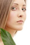 Natural beauty. Bright picture of lovely woman with green leaf Stock Images
