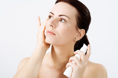 Natural Beauty Applying Lotion Royalty Free Stock Images