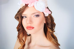 Natural Beauty. Beautiful woman with flowers. Beautiful girl royalty free stock photo