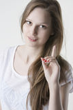 Natural beauty blond woman with her finger up. Portrait of young attractive woman with gorgeous long blond hair, showing her finger up. Isolated over light Royalty Free Stock Photos