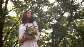 Natural beauty girl with bouquet of flowers outdoor in freedom enjoyment concept. stock video