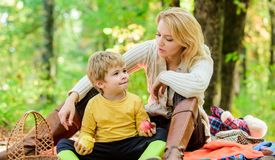 Natural beauty. Happy son with mother relax in autumn forest. Family picnic. Mothers day. Spring mood. Happy family day royalty free stock image