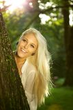 Natural beauty hiding behind a tree Royalty Free Stock Image