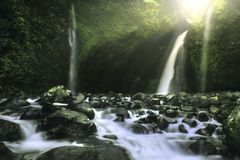 Beauty sunset light with amazing skythe natural beauty of indonesian waterfall royalty free stock image