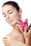 Natural beauty with lily. Natural beauty woman eyes closed with lily in hand Stock Photography
