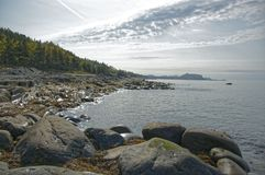 Natural beauty on the nature. This place is in a bay. In the distance we see mountains. It is a nice place to walk. Photo taken in September 2008 on the shore Royalty Free Stock Photos