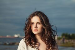 Natural Beauty. Nice Woman with Long Curly Hair. Outdoors royalty free stock images