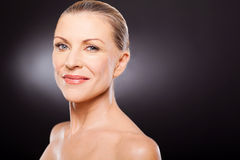 Natural senior beauty. Natural beauty senior woman on black Stock Image