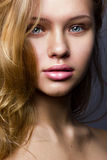 Natural beauty vertical portrait of a blond. Natural beauty portrait of nice young girl with blond hair stock images