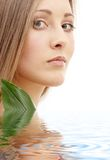 Natural beauty in water. Bright picture of lovely woman with green leaf in water Royalty Free Stock Image
