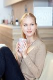 Natural beauty woman drinking tea at home Royalty Free Stock Photography
