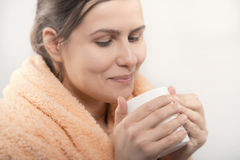 Natural beauty woman having cup of coffee or tea royalty free stock photo